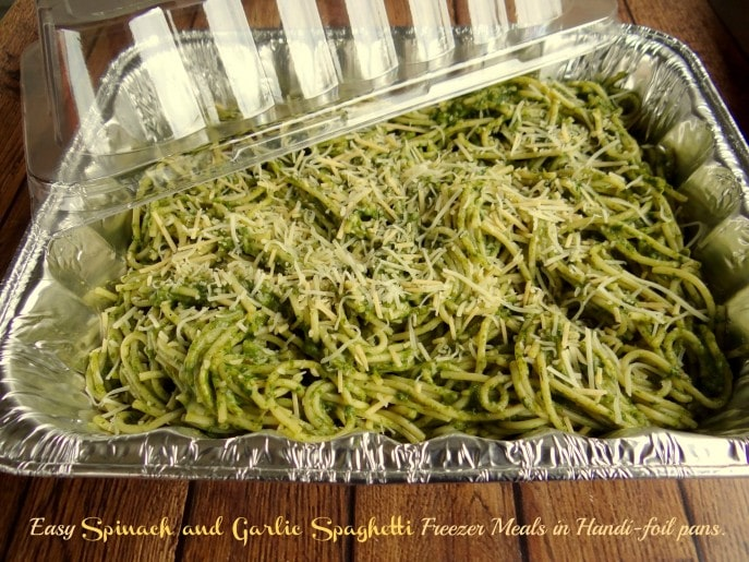 Making Spinach and Garlic Spaghetti Freezer Meals in Handi-foil pans.