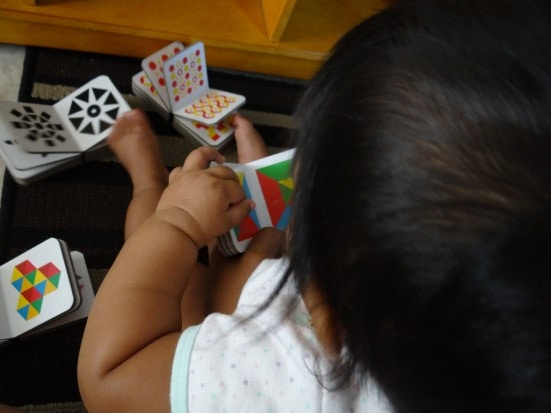 My little one grabs these mini sized board books and flips a few pages before attempting to teethe on the ends! The bright colors and patterns do hold her attention for a while.