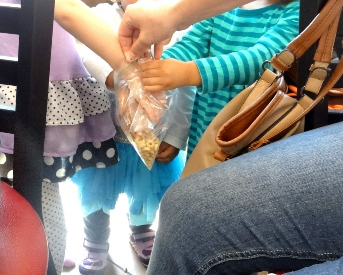 It never fails. Feed a little one a good meal and she will still reach for the cereal bag when it comes around!