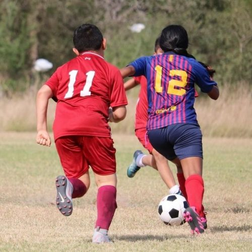 girl and soccer- MommySnippets.com
